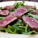 Beef Tagliata with rocket salad and truffle oil
